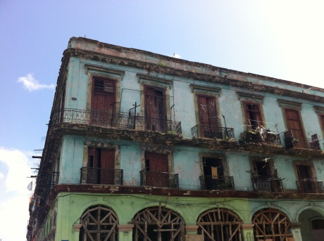 It's often impossible to figure out which buildings in old Havana are inhabited. This is just one example of a beautifully decrepit corner building. Photo credit: Tazi Phillips