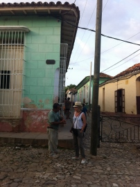 Mom talking to a local in the streets of Trinidad, Cuba. Photo credit: Tazi Phillips